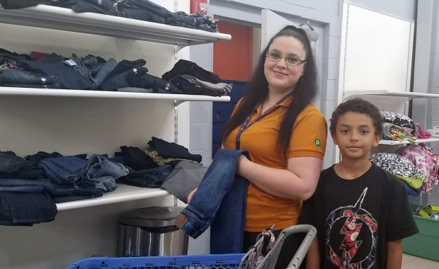 Mother and son shop for jeans in the Free Store