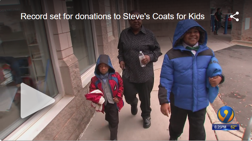 Image serves as link to view video on WSOC TV's site. Image shows Betty and her grandsons on the sidewalk with coats they selected free-of-charge at Crisis Assistance Ministry.