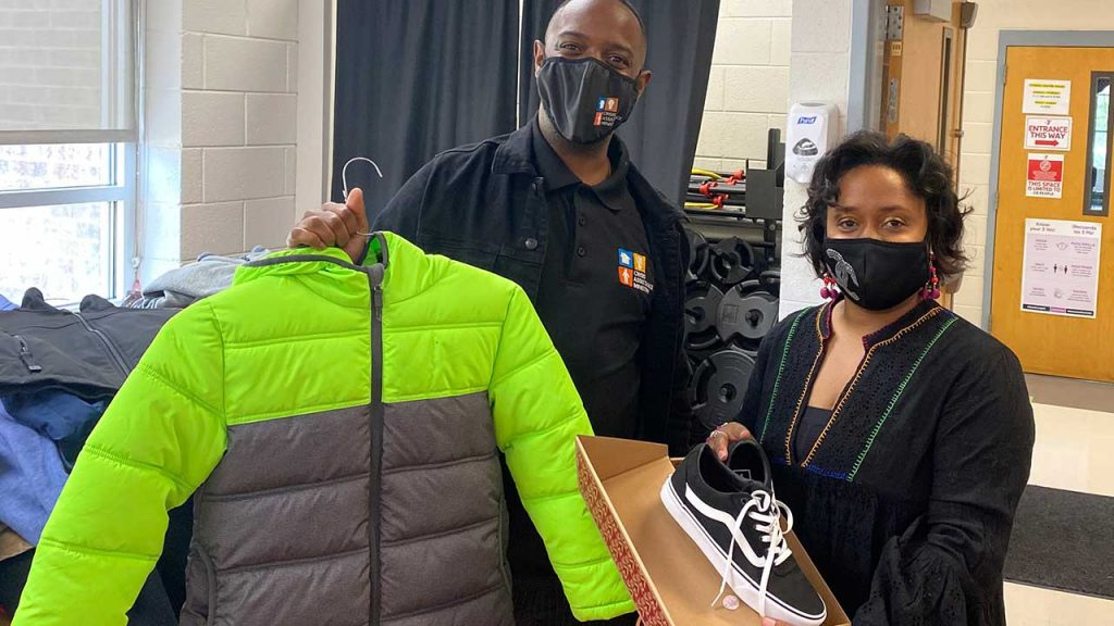 Crisis Assistance Ministry's Phillip Miller (left) welcomes Raukell Robinson, Family and Community Engagement Manager for Charlotte Mecklenburg Schools' Central 1 Learning Community, and staff from 29 CMS schools to shop for their students.