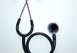 Image of stethoscope on neutral background